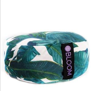 Bloom round meditation pillow in a palm leaf print